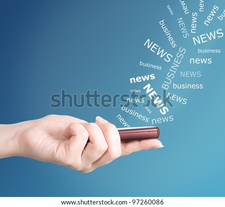 Hand holding modern mobile telephone. Business news concept - stock photo