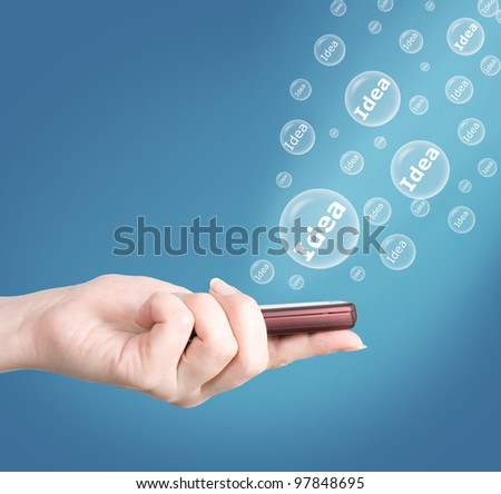 Hand holding modern mobile telephone. Idea concept - stock photo