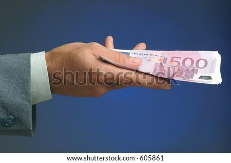 Hand holding money - stock photo