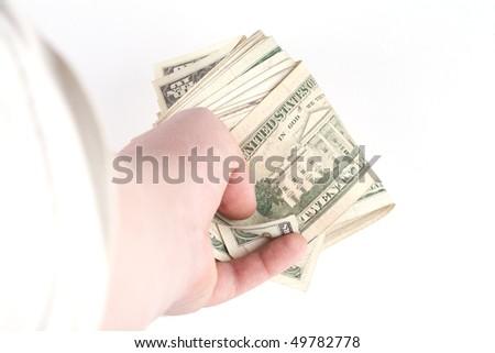 Hand holding money , studio shot on white background - stock photo