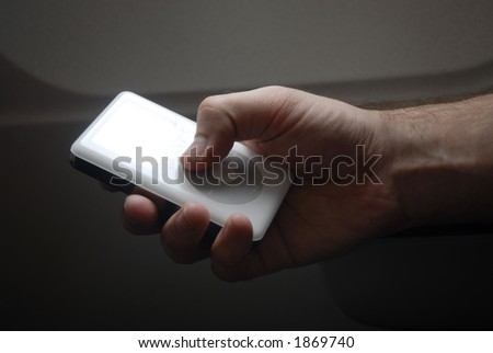 hand holding mp3 player - stock photo