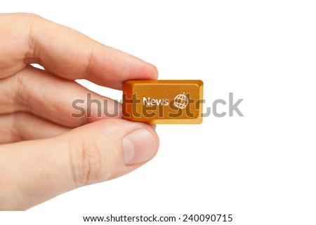 hand holding news computer key - stock photo