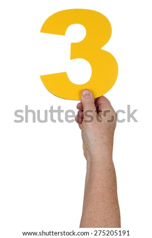 Hand holding number 3 isolated on a white background - stock photo