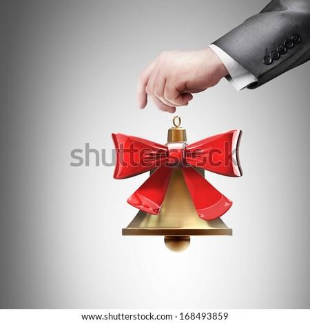 hand holding object (Christmas handbell) High resolution  - stock photo
