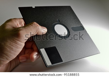 hand holding old format Diskette of 5,25 inches - stock photo