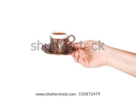 Hand holding or serving traditional Turkish coffee, isolated on white background.