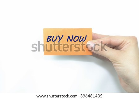 hand holding orange card written buy now over isolated - stock photo