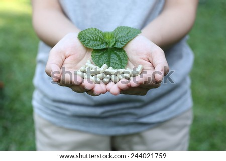 Hand holding Organic capsule medicine for good health and good life - stock photo