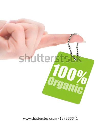 hand holding 100% organic label isolated on white background - stock photo