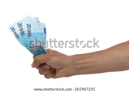 Hand holding out Euro bills isolated on white  - stock photo