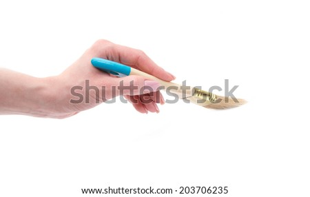 hand holding paint brush isolated over white background