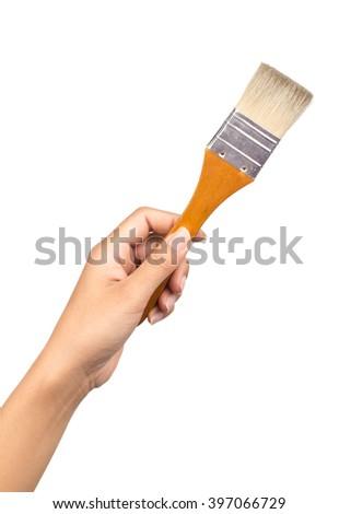 Hand holding painting brush isolated on white background - stock photo