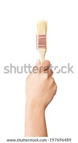 Hand holding painting brush on white background - stock photo