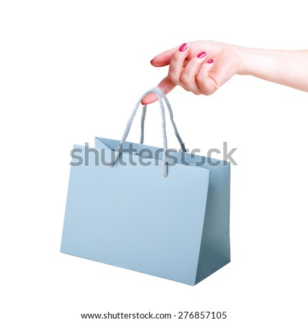 hand holding paper bag - stock photo