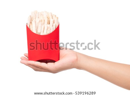 hand holding paper bag of fried taro snacks isolated on white background