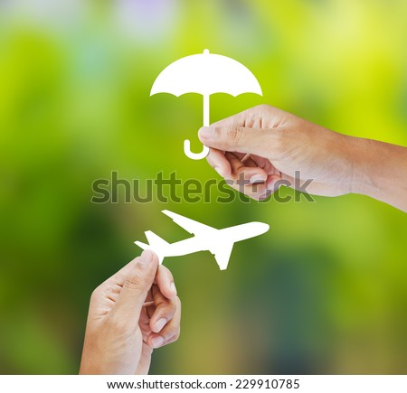 Hand holding paper on green background, Travel Insurance - stock photo