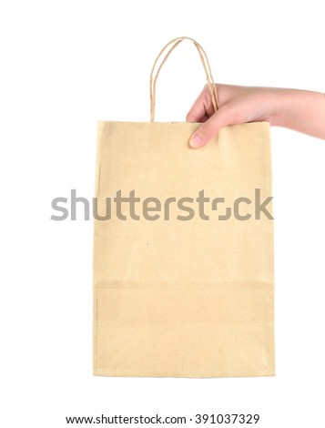 hand holding paper shopping bag on white bagground