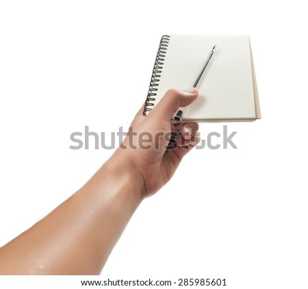 hand holding pen and notebook isolated over white background