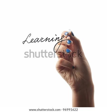 Hand holding pen isolated on white background - stock photo