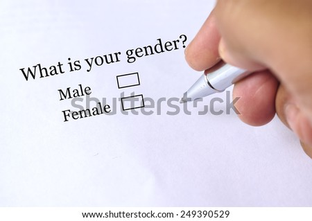"""Hand Holding Pen to Tick """"GENDER"""" On Questionnaire , Selective Focus - stock photo"""