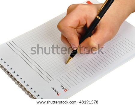 Hand holding pen writing on notebook paper. Isolated on white