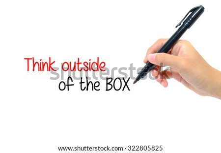 Hand holding pen writing words think outside of the BOX concept. - stock photo