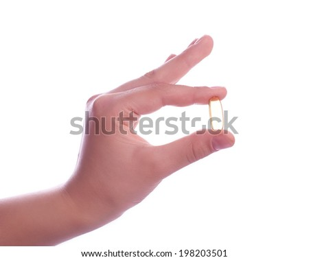 hand holding  pills on white background,studioshot - stock photo