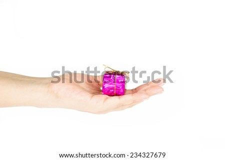 Hand holding pink gift box on white background - stock photo