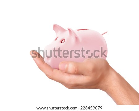 hand holding pink piggy bank on white background