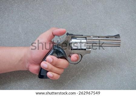 hand holding pistol gun - stock photo