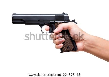 Hand holding pistol gun, finger on the trigger 11 mm - stock photo