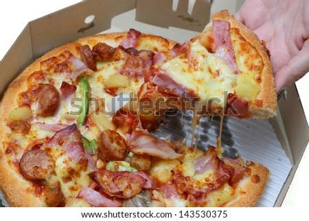 hand holding pizza - stock photo
