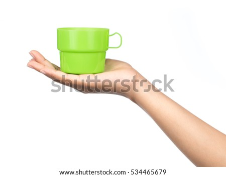 hand holding Plastic glass isolated on a white background.