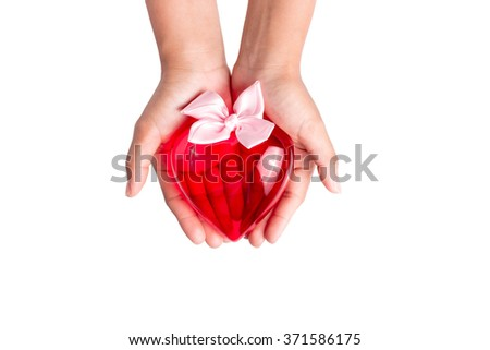 hand holding plastic heart on white background , Concept for valentine  - stock photo