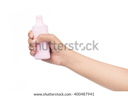 hand holding plastic pink bottle isolated on white background