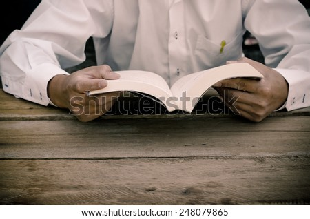 hand holding pocket book to read - stock photo