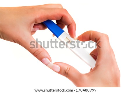 Hand holding positive result pregnancy test - stock photo