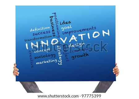 hand holding Poster Innovation concept and other related words - stock photo