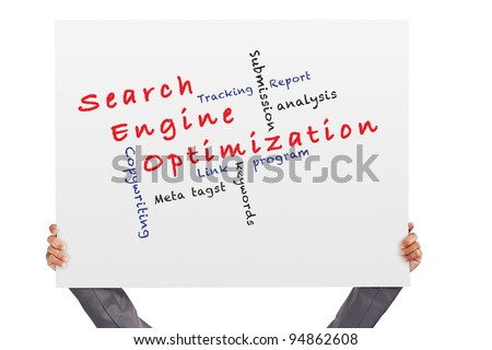 hand holding Poster Search engine optimization ( SEO) and other related words - stock photo