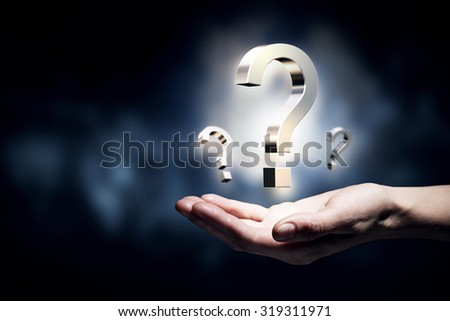 Hand holding question mark on a white background - stock photo