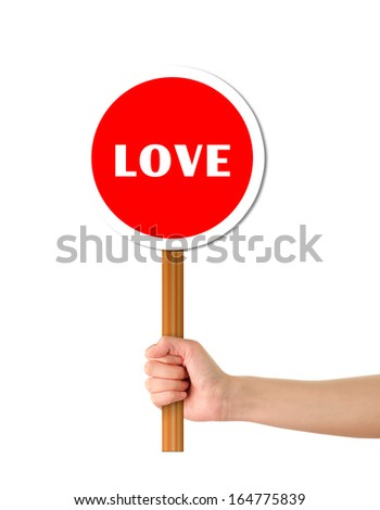 Hand holding red alert sign - stock photo