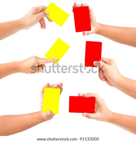 Hand holding red and yellow cards isolated on white. With Save path for Change the background - stock photo