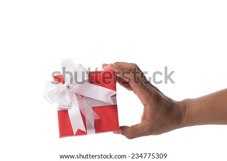 Hand holding red gift box on white background - stock photo