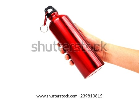 hand holding red metal thermos Bottles isolated on white - stock photo
