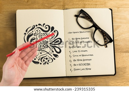 Hand holding red pencil against overhead of reading glasses with notebook - stock photo
