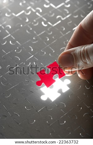 hand holding red puzzle piece - stock photo