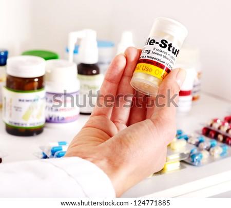 Hand holding remedy.  Medicine. - stock photo