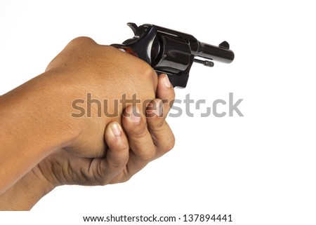 Hand holding revolver on a white background - stock photo