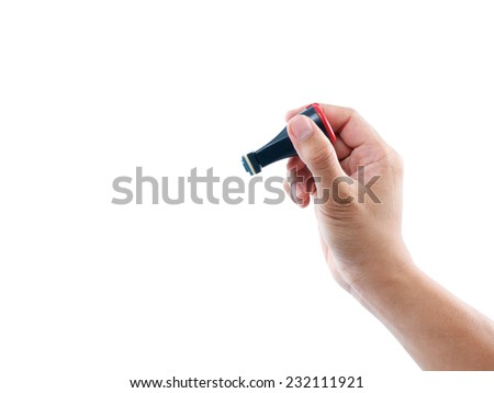 hand holding rubber stamp on white background