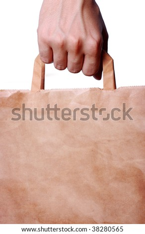 hand holding shopping bag, with space to your text or image - stock photo